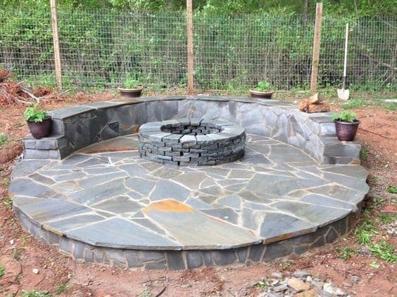 Stone veneer fire pit patio
