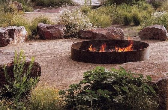 Iron raised fire pit that adds a rustic charm