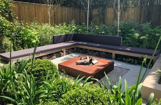 Modern fire pit with cushioned seating