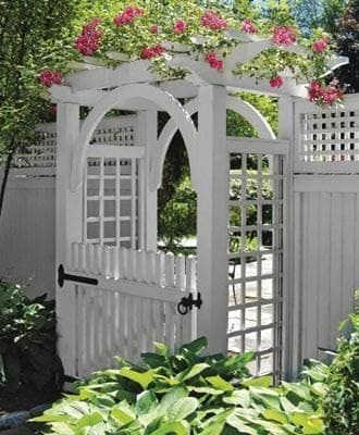 White arbour gate with flowers