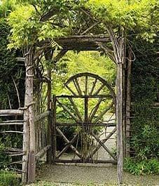 A unique garden gate made of logs