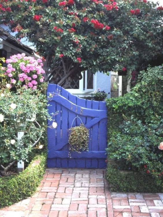 Blue small gate with hanging basket
