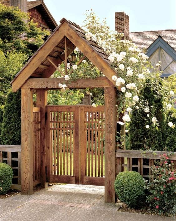 A stylish gated arbour with surrounding greens and florals