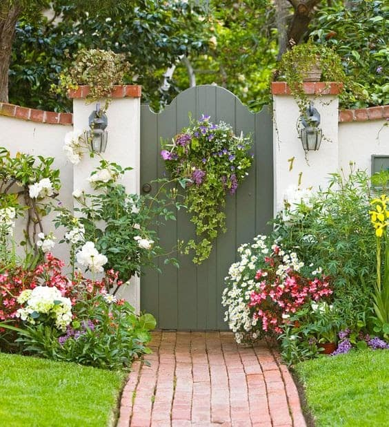 Wooden gate combines with colourful flowers