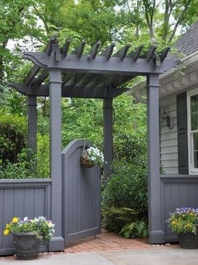 Grey gated arbour and fence