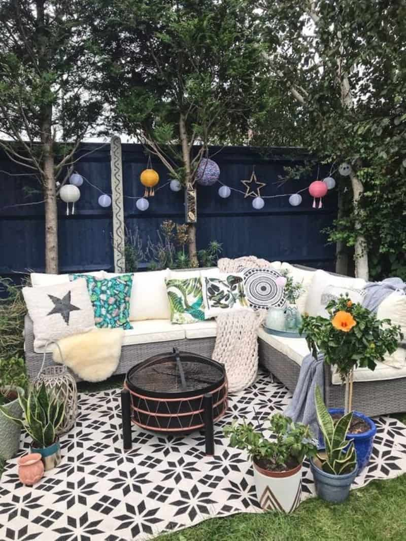 Spring garden vibe with an outdoor rug under the seating area