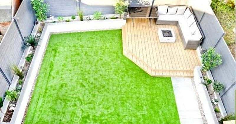 Aerial view of a corner deck with a comfortable seating area and lawn