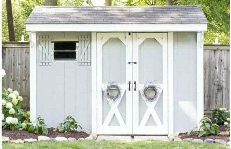 An old shed transformed into a farmhouse-style paint job