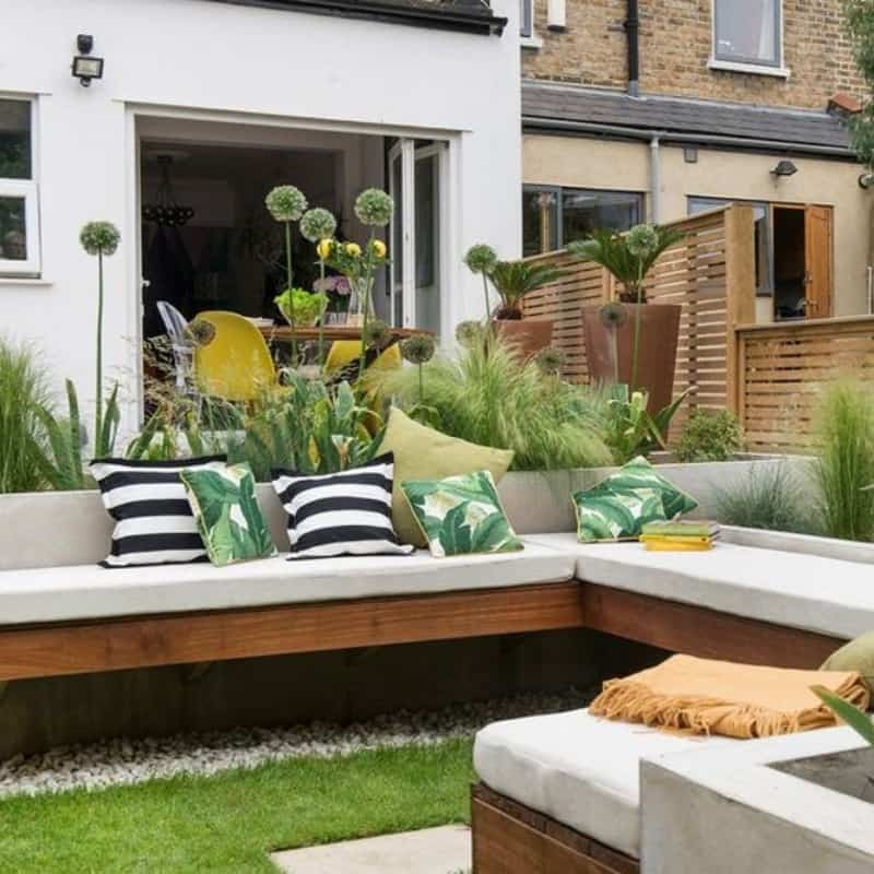 Multi-zoned garden with a dining table and a comfy couch