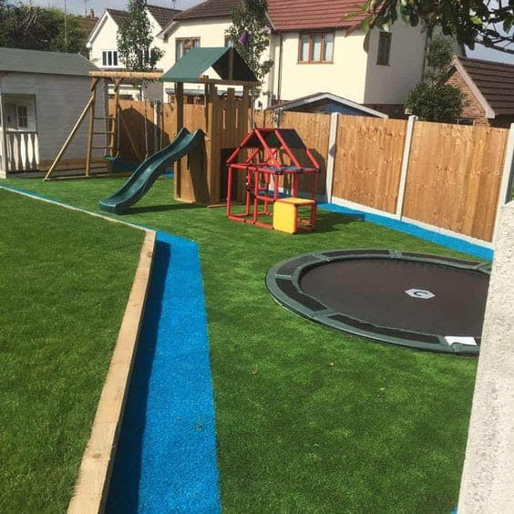 A garden playground area with artificial grass