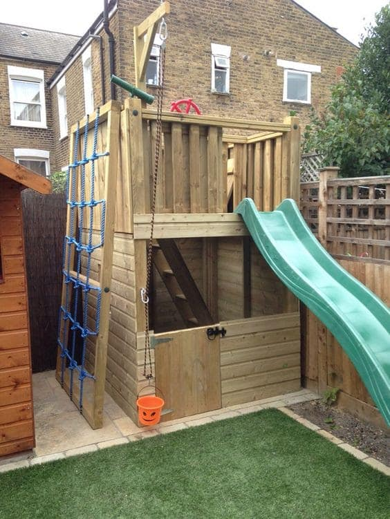 Wooden treehouse in small garden