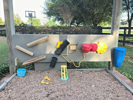 Activity wall and pea gravel area
