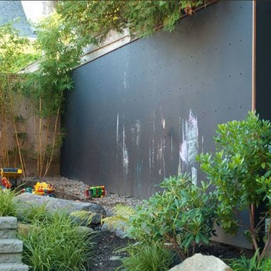 Chalkboard wall attached to a garden wall