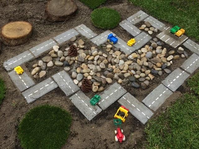 Mini city made of concrete and pebbles
