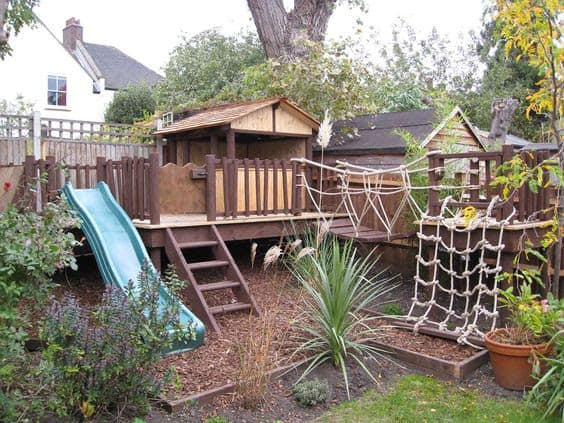 An awesome treehouse with a slide, a hanging bridge, even some ropes to climb