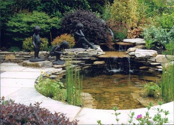 A garden pond decorated with statues