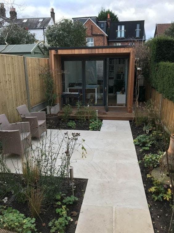 A modern cabin installed in a long, narrow garden