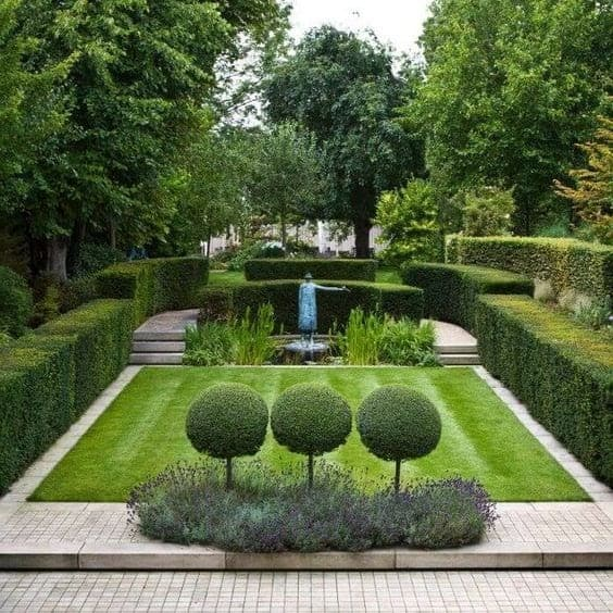 Perfectly pruned hedges and trees in a well-manicured garden