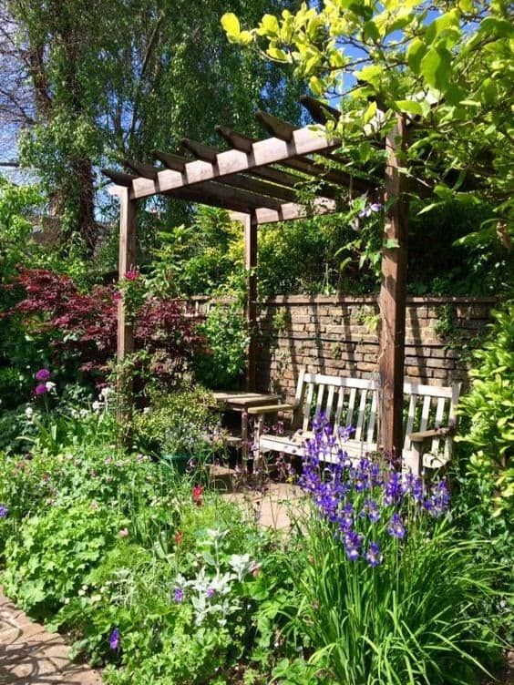 Wooden side pergola with bench