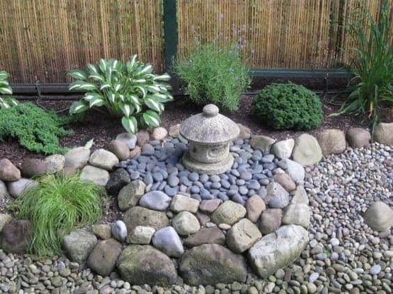 A small lantern on a rock garden