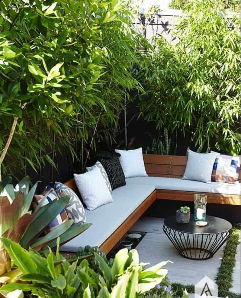 A mini outdoor space with hedges for privacy