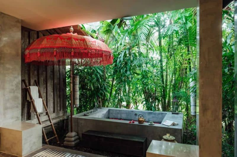 A mini hot tub decorated with tropical-inspired decors