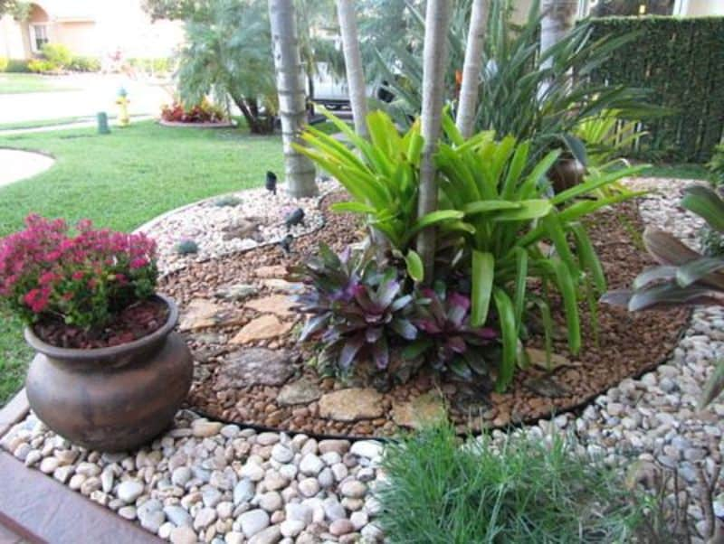 Stones and mortar, creating a garden bed filled with tropical plants