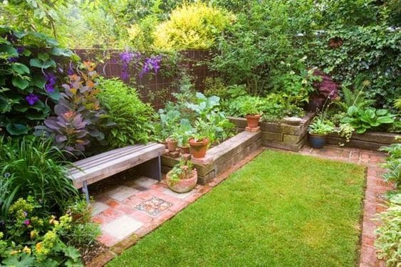 Bricks flower beds with surrounding plants