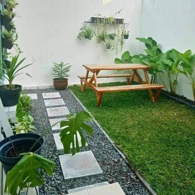 Open simple garden with a picnic table