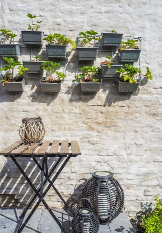 Floating pots on a plain white wall