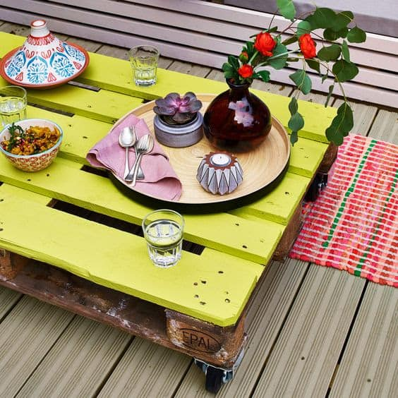 Pallet garden table painted in yellow green