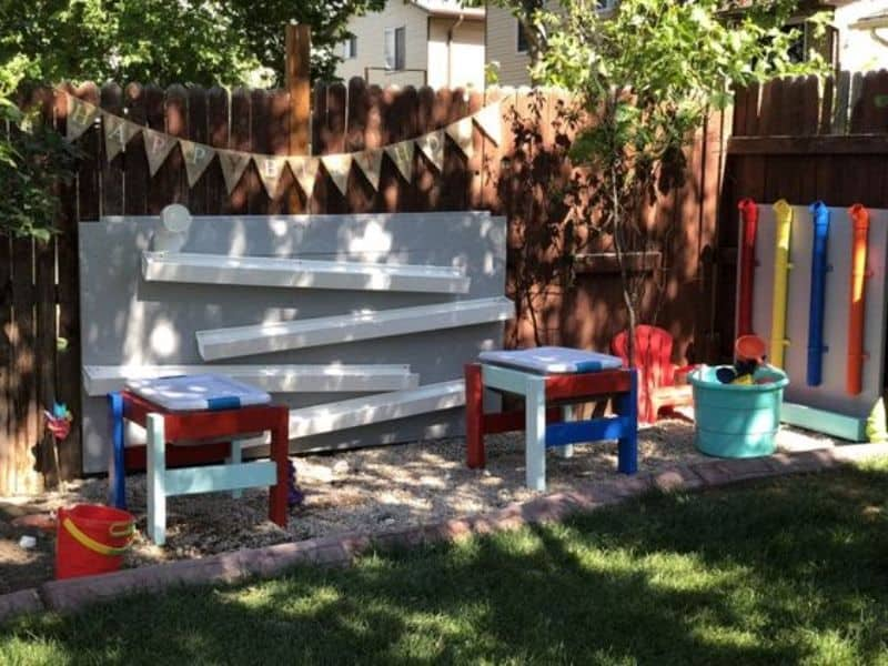 Leftover wood and pipes in bright colours for children's play area