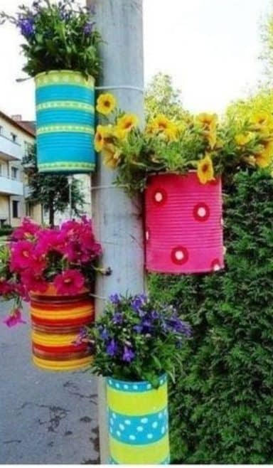 Recycled old cans turned into pretty hanging garden pots