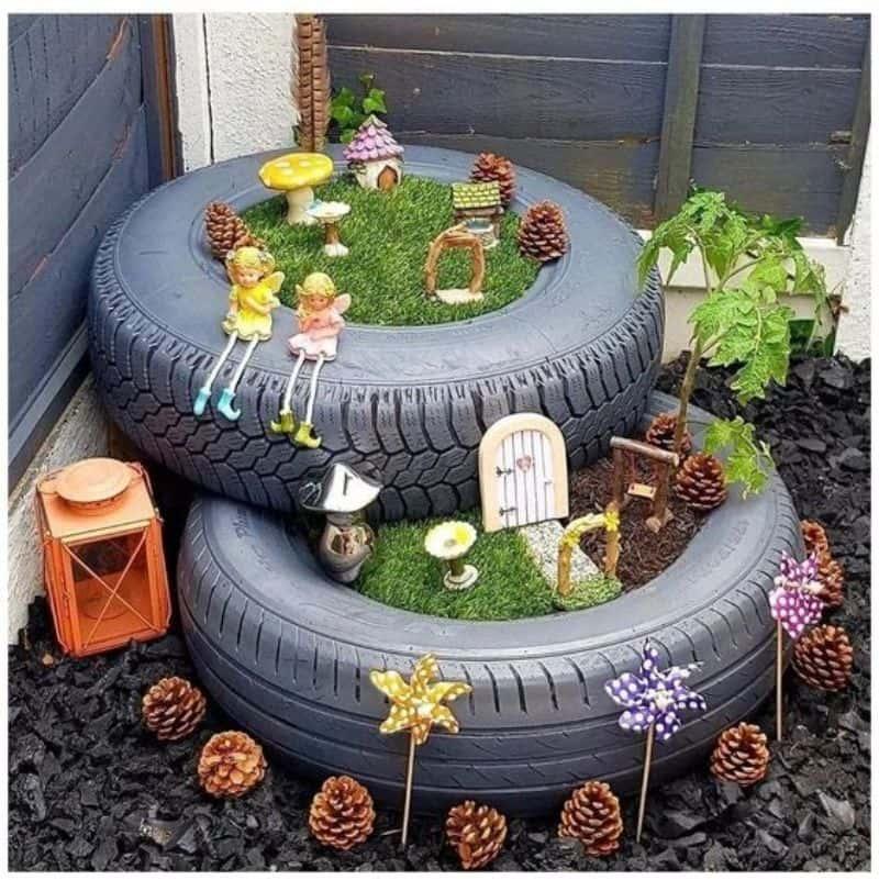 Mini fairy garden in recycled tyre