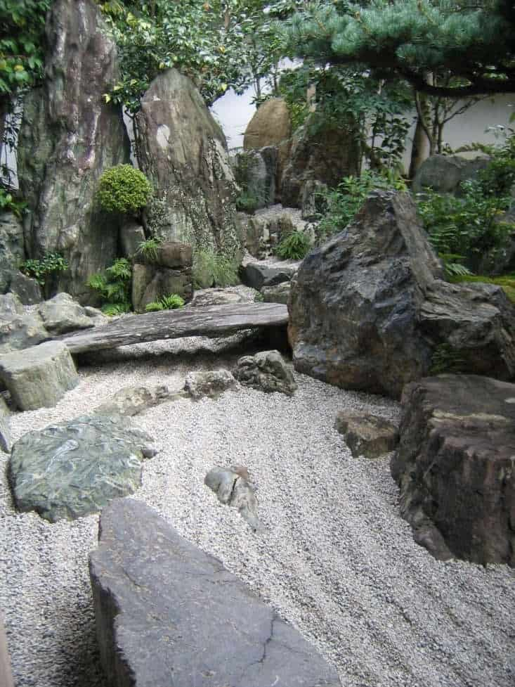 A dry waterfall with sand or gravel that represents as water