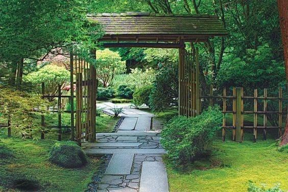 A zen garden with a traditional Japanese gate