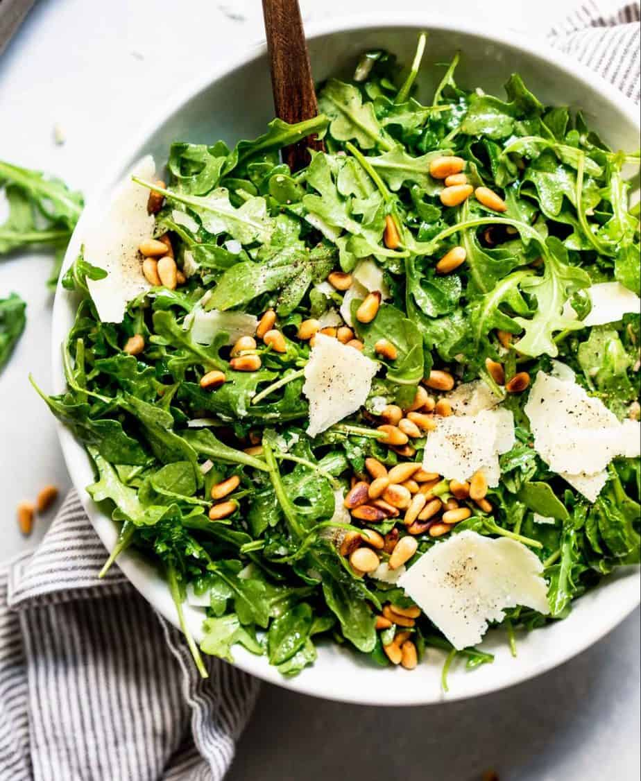 Rocket salad with dried sunflower seeds and cheese