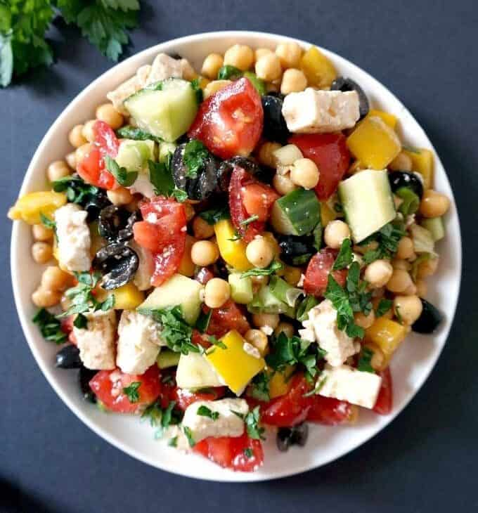 A bowl of Mediterranean chickpea salad with loads of toppings
