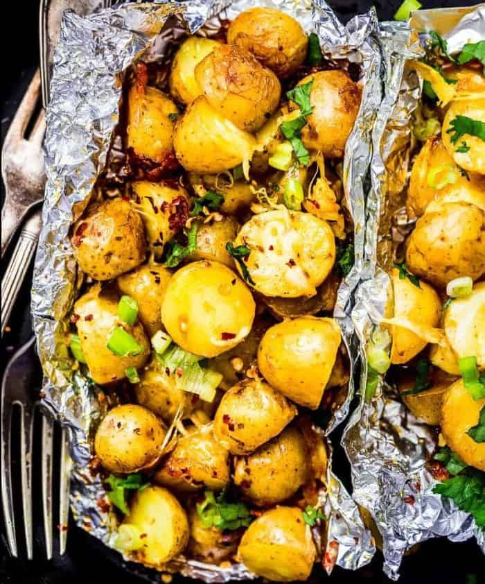 Cheesy campfire potatoes wrapped in tinfoil