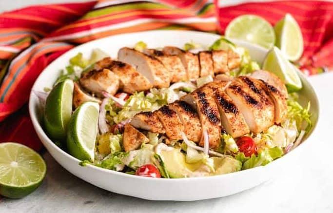 Grilled fajita chicken salad with sliced green lemons