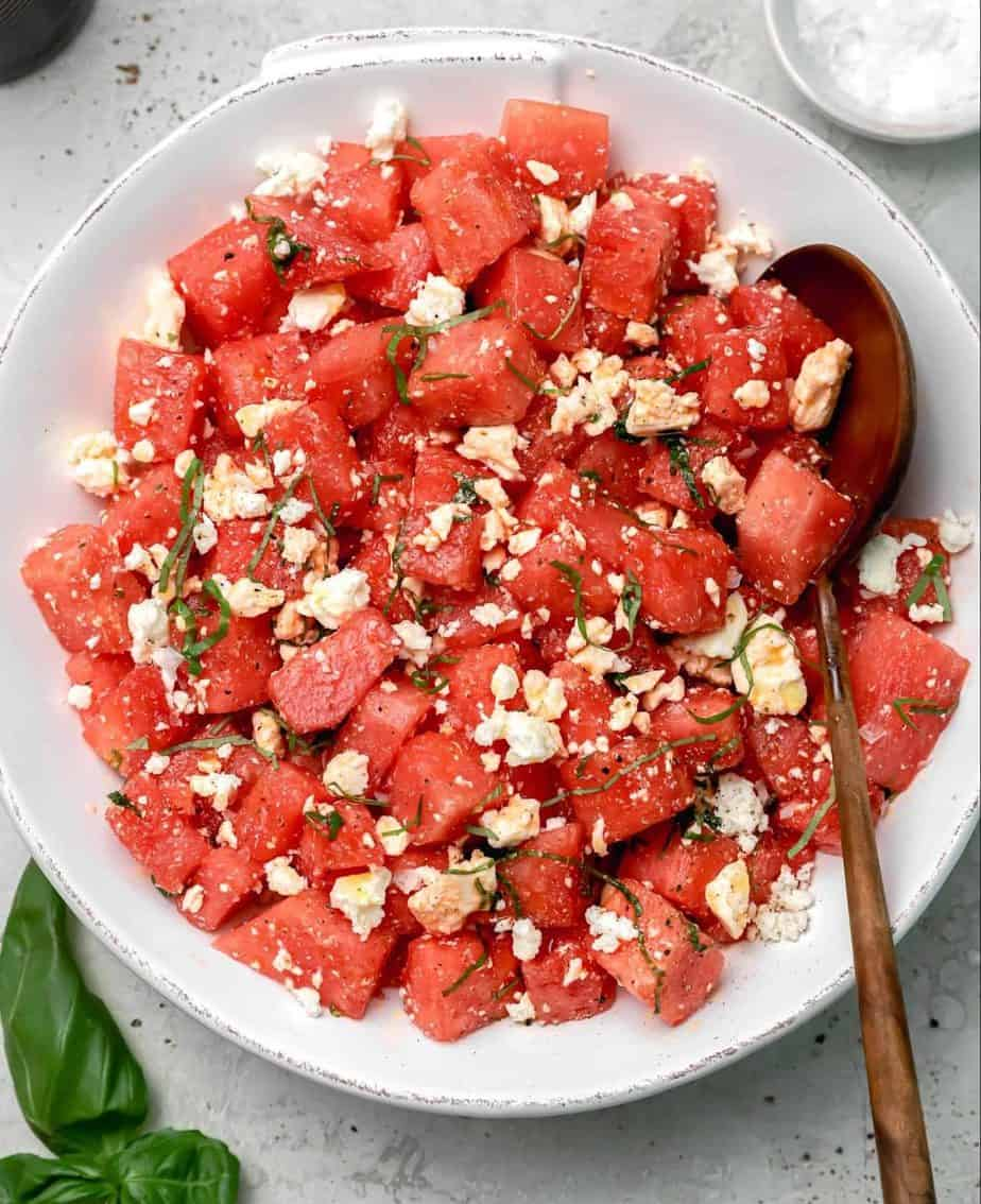 A bowl of watermelon salad with feta cheese