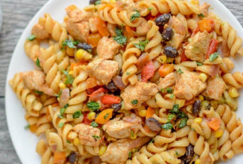 BBQ chicken pasta salad with a variety of garnish