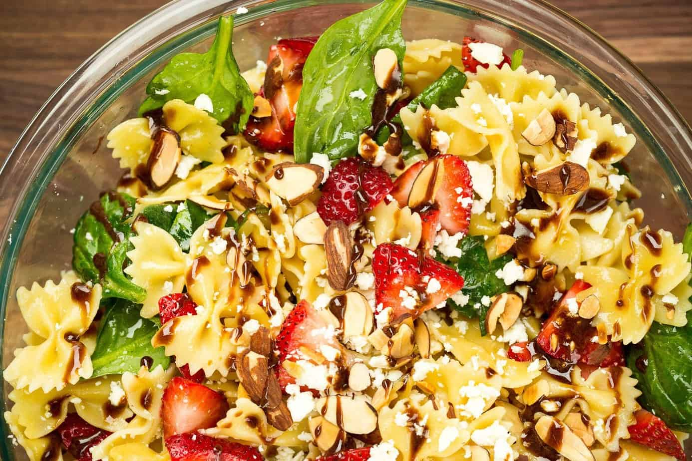 A bowl of strawberry pasta salad with balsamic dressing