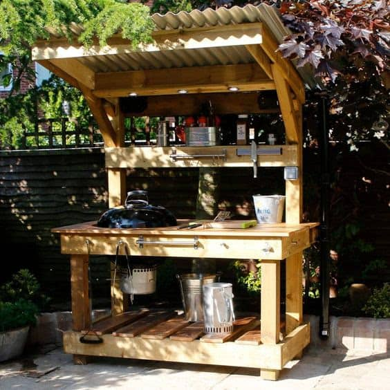Custom-built BBQ station with table made from timber