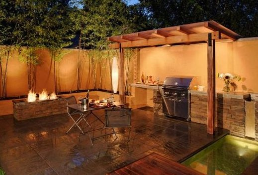A semi pergola BBQ shelter placed in an outdoor seating area with a fire pit