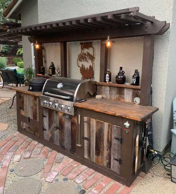Rustic BBQ wall setup with dark wood