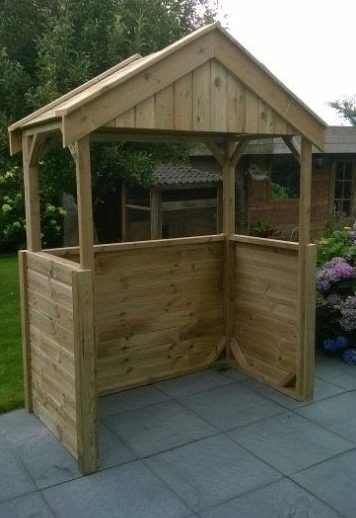 Small simple BBQ shed with open windows for smoke to find its way out