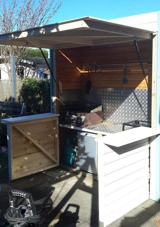 Foldable outdoor kitchen setup for outdoor grilling