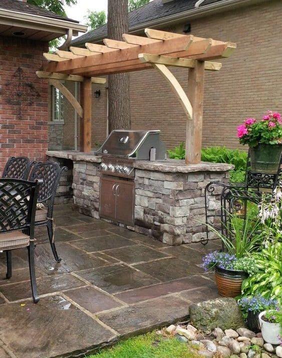 Stone BBQ area with simple pergola