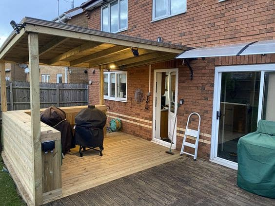 A BBQ area with a covered deck